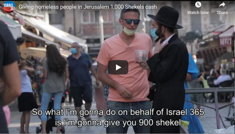 Israel365 David Sidman handing out money in Jerusalem